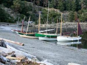 Here's Wayward Lass (green) and Bluster (white) on the beach at Sucia, among some of the other boats. Chebaccos are a little heavy to pull up and down the beach, but they have no problem nosing in to load and unload. A stern anchor can be helpful getting off again. (John Kohnen photo)